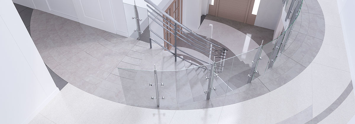Image of a modern residential front entrances with custom floor tiles looking down from second floor.